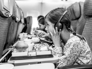 cn_image.size.kid-eating-on-plane-getty